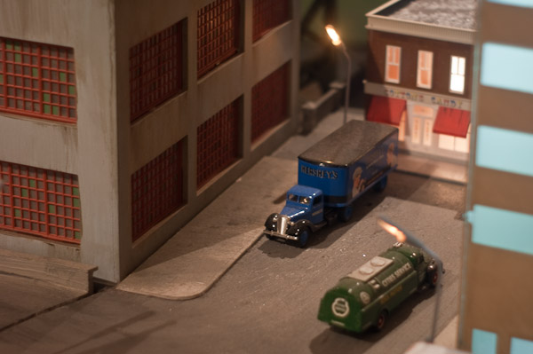Trucks outside a model of a candy store