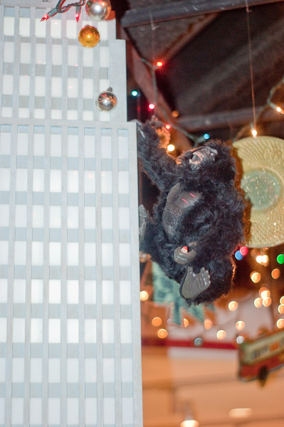 Stuffed King Kong climbing a model of the Empire State Building