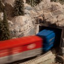 Lionel Freight Train speeding through the Tunnel